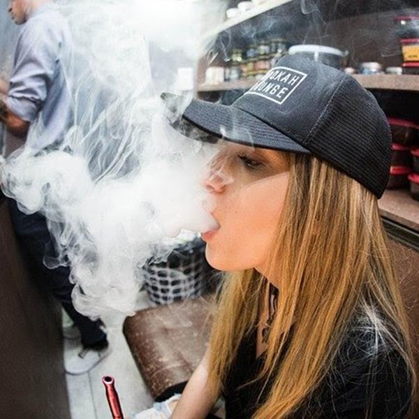 Woman Blowing Vapor