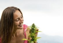 girl looking at cannabis